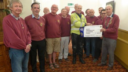 Freewheeler volunteer rider Charlie Hutching met the Lions at the Anchor Inn, Sidmouth and received