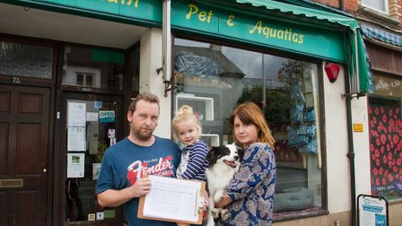James and Liza McLean with their petition with their daughter Eris and dog Fink. Ref shs 39 19TI 168