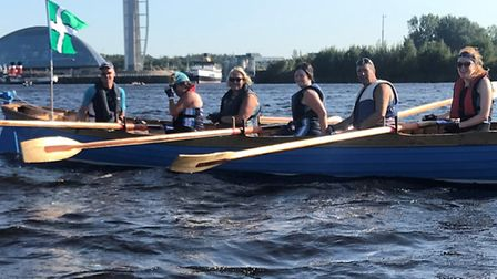 After two hours and 51 minutes of hard rowing, Little Picket's crew take a breather. (Left to right)