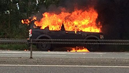 Craig Proctor and his partner were driving from Honiton to Exeter when they saw the car engulfed in