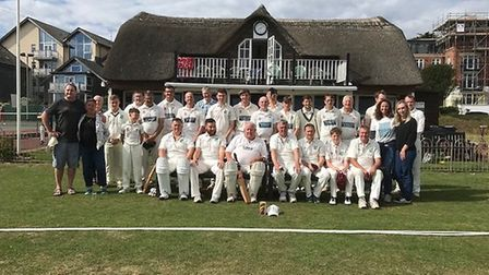 Sidmouth and Newton Poppleford cricket teams who met to honour the memory of Ian French who passed a