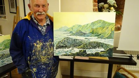 Artist David Clarke with one of his seascapes. Picture: Sidmouth Society of Artists