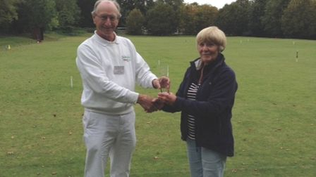 Pam Bowra, the non-playing captain of the Sidmouth team that won the grand final receives the trophy