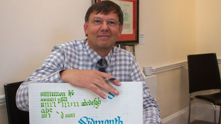 Simon Gray of Exeter Letterers at the Exhibition in Kennaway House, Sidmouth. Ref shs 40 19TI 2064.