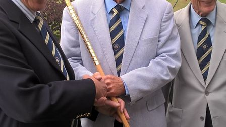 Sidmouth Golf Club's David Bromage is presented with the Walking Stick. Also in the picture are curr