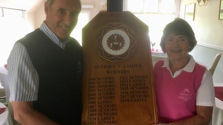 Sidmouth Senior captain, Chris Grubb, receiving the Millenium Plate from ladies captain, Gill Paddon