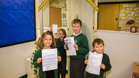 Ottery primary school pupils Joe,Rory,Annabelle and Emma with their work inspired by a mysterious do