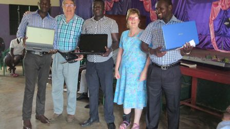The Sid Valley community help buy three laptops to our staff. On the left is Pastor Charles, in the