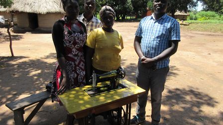 The charity loaned Winifred a sewing machine to help her start her business. JB, our sewings School