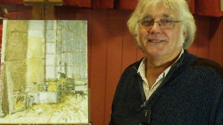 Artist Colin Allbrook with his picture of the inside of a barn. Picture: Otter Vale Art Society