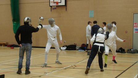 Sidmouth & East Devon Fencing Club members warm-up with their coaches. Picture SEDFC