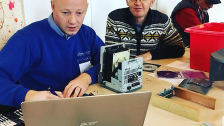 Al Findlay uses his knowledge to fix a laptop at Sidmouth Repair Cafe. Picture: Sidmouth Repair Cafe