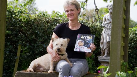Jo Earlam with her new book based on her dog Archie. Ref shs 18 19TI 3473. Picture: Terry Ife