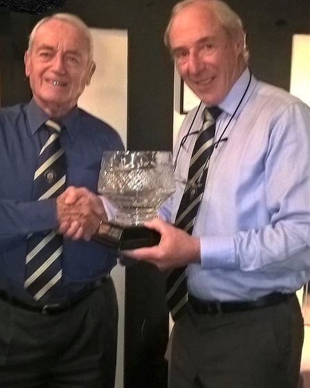 Rob Owen receives the Charity Bowl from senior captain Chris Grubb. Rob, some 87-years-young, has be