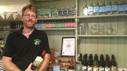 John Hammond with his new Port Royal Rum which is added to his Sidmouth Gin and Sidmouth Vodka range
