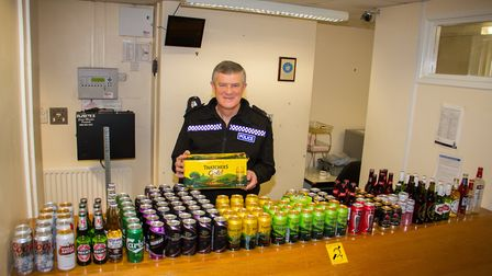 Andy Squires donates confiscated alcohol to Sid Valley Food Bank so that they can auction it. Ref sh