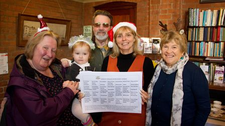 Andie Milne and members of the food bank with the reverse calendar. Ref shs 46 19TI 4096. Picture: T