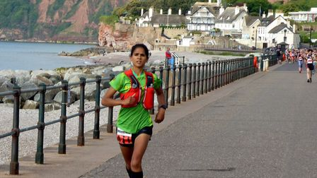 Sidmouth Running Club's Kirsteen Welch leading the way in the Women Can Marathon. Picture KIT WOODCO