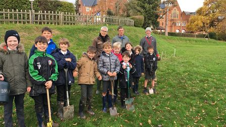 Youngster sfrom St John's School planting trees with Jon Ball, Ed Dolphin and Graham Hutchison, of S