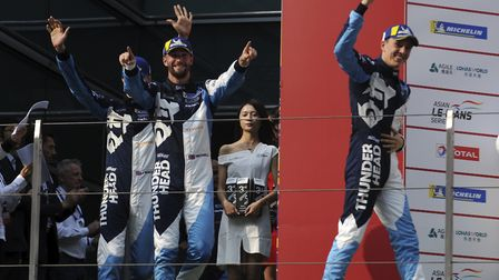 Harry Tincknell celebrates with his team mates after their win at the opening round of the Asian Le