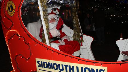 Sidmouth late night shopping. Sidmouth Lions Club Santa sleigh made its way through town. Ref shs 22