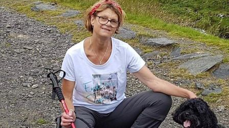 Deborah Parsons with her dog while climibng Mount Snowdon, 24 hours before discovering she had breas