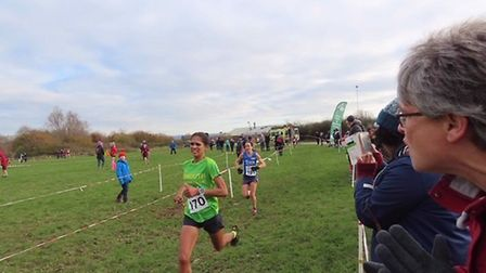 Sidmouth Running Club's Kirsteen Welch crossing the line to take 1st place in the South West & Inter