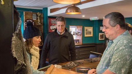 Hugh Grant meets pub landlord Ade in The Swan Inn during his visit in Sidmouth to help Claire Wright