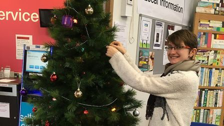 Decorating the tree at Sidmouth Library. Picture: Sidmouth Library