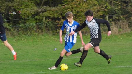 Seb Copp (left) who scored a hat-trick in the Ottery U14s 9-2 win over Culm Sampford. Picture STEPHE