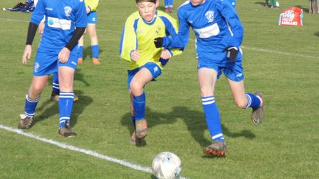 Ottery St Mary Under-14s player George Durham in the thick of the action during the 6-2 win at Brixi