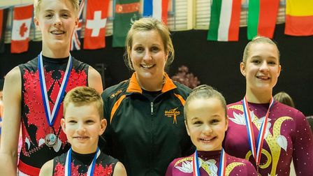Helen Reddy, pictured with some of her medal-winning gymnasts.