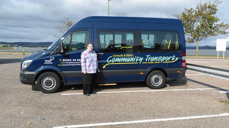 Exmouth Community Transport chairman Jill Elson with one of their buses. Picture: Exmouth Community