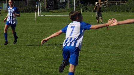 George Durham celebrates one of his three goals in the Ottery St Mary U14s win over Okehampton. Pict