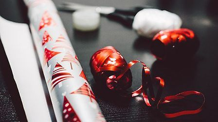 Wrapping Christmas presents.