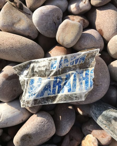 Sidmouth Plastic Warrior member Rachel Perram found a 34 year old wrapper on Sidmouth beach. Picture