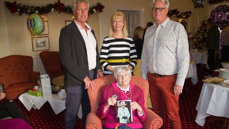 Frances Meek celebrates her 100th birthday with her sons Christopher and Melvyn and daughter June. R