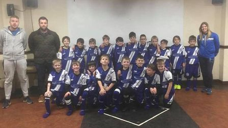 Ottery St Mary U9s in their new kit provided by generous sponsorship from local companies C M Hill C