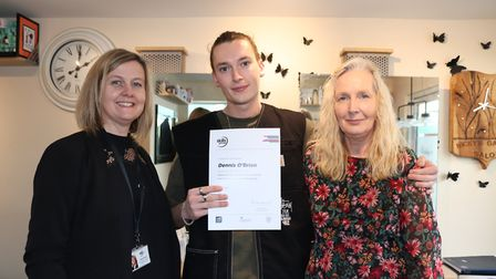 Dennis receiving his distinction, with Helen Morrish from Skills Group and his mother Nicky, at her