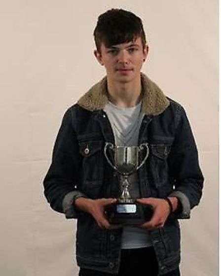 Dylan Roberts with his Michelmore Cup for outstanding achievement in music. Picture: Sidmouth Colleg