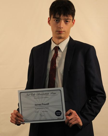 Jamers Farwell with his Sid Vale Association prize for goegraphy, history and citizenship. Picture: