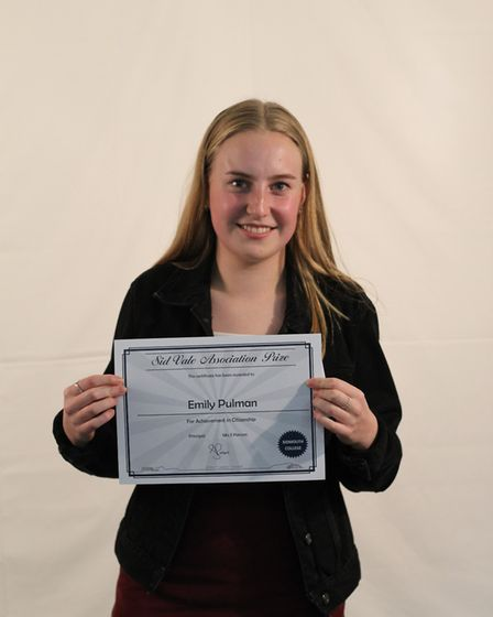 Emily Pulman with her Sid Vale Association prize for geography, history and citizenship. Picture: Si