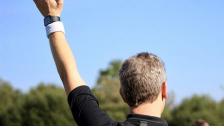 A match referee signals a free-kick with his arm aloft. Picture SARAH MCCABE