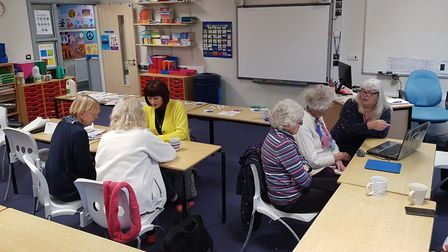 Residents got help with their computers and smartphones at the drop-in session. Picture: Ben McGowa