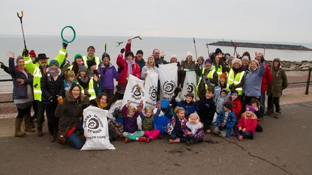 Denise Bickley with Sidmouth beach clean volunteers, in February 2019. Ref shs 02 19TI 7826. Picture