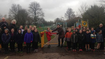 Children from Tipton St John Primary School at the opening of the village's new pay park. Picture: D