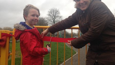 year three pupil Soloman cutting the ribbon on the new play park. Picture: Daniel Wilkins