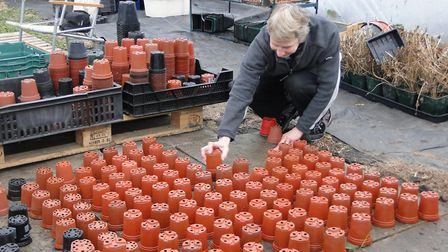 Sue Goode with some of the pots that had to be cleaned. Picture; Sidmouth in Bloom