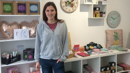 Laura Saunders with the crafts and giftsin her shop. Picture: Laurylee