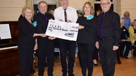 A cheque for £1,000 was handed over to charity directors Ros and Graham Green by the choir's musical